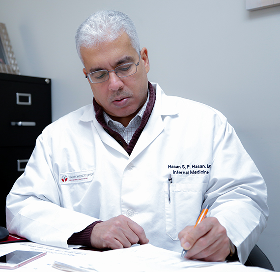 Dr. Hasan witha patient